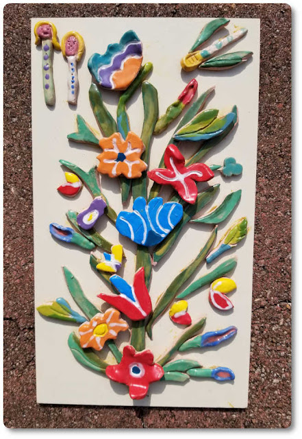 How to hang clay art arrached to wood