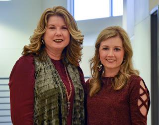 Two women standing in a hallway