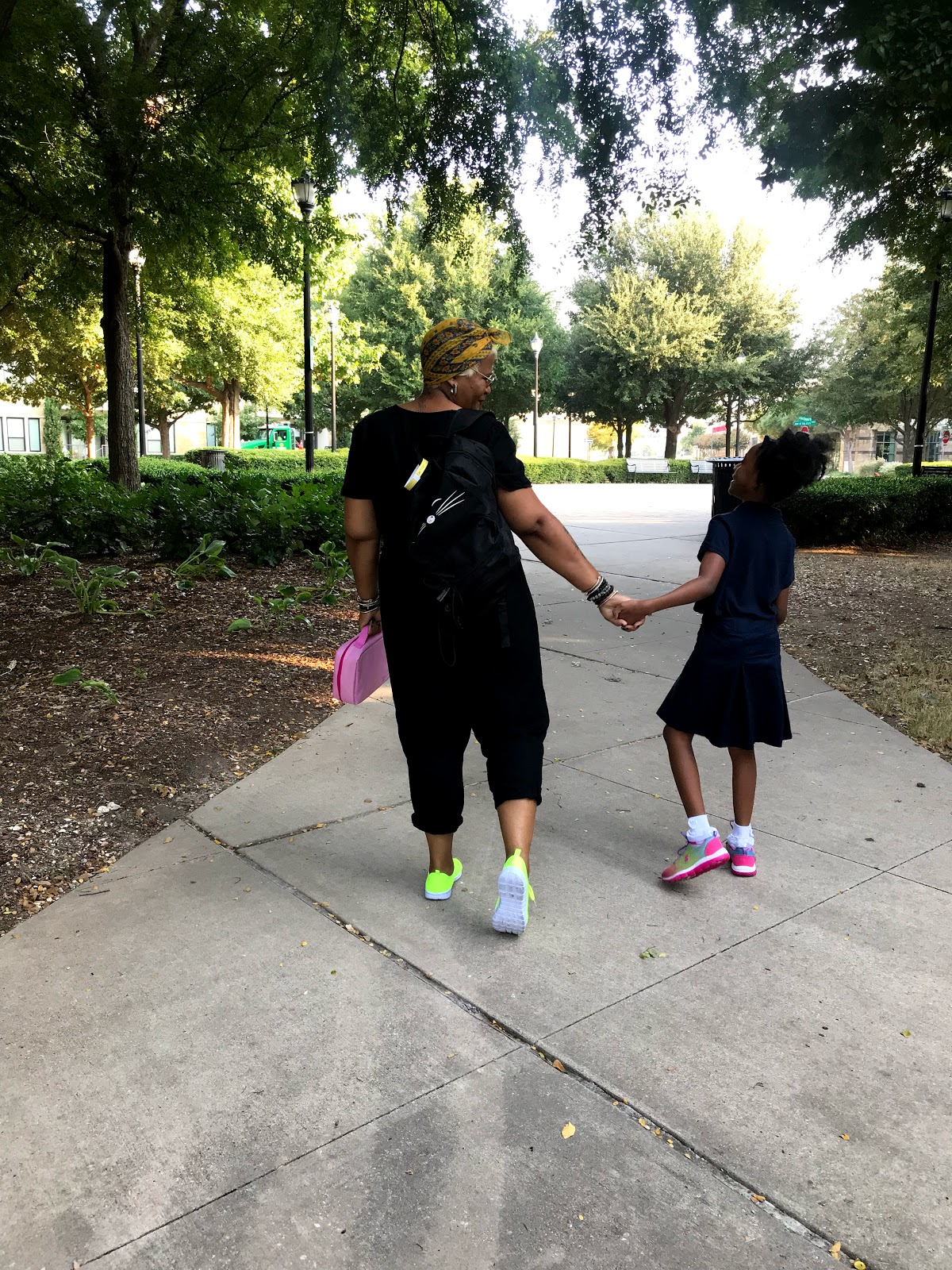 Image: Tangie Bell walking her daughter to school as part of Bits and Babbles routine with her 2nd grader