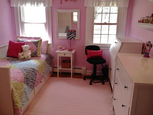 Pink tween girl's bedroom with rainbow zebra quilt
