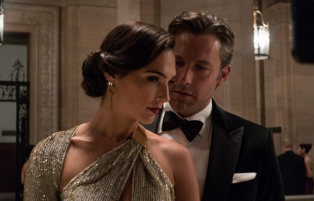 Gal Gadot (left) as Wonder Woman with Bruce Wayne (Ben Affleck)