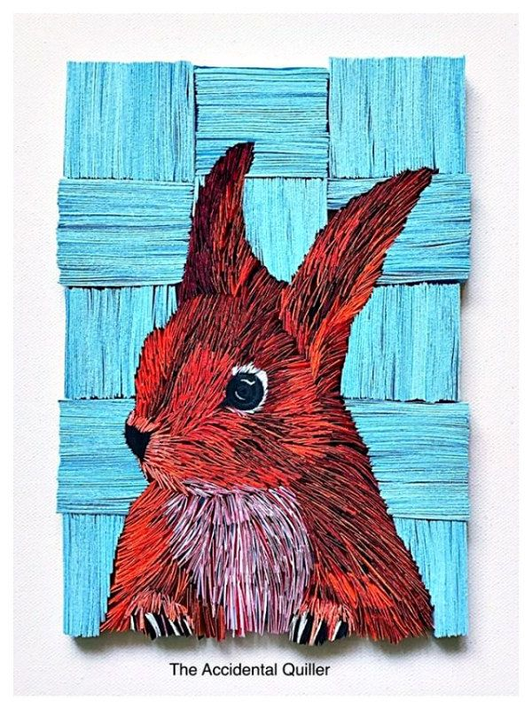 layered paper rabbit wall art composed of paper strips