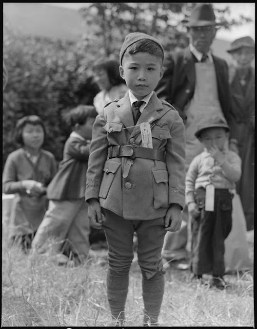 Internee waits for the evacuation bus, 9 May 1942 worldwartwo.filminspector.com