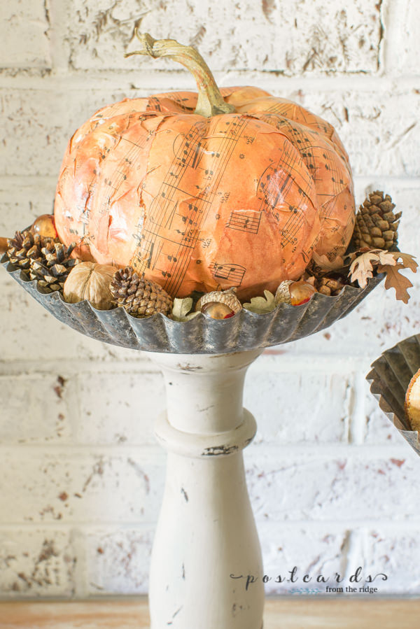 rustic diy pedestal stand with paper mache pumpkin and acorns