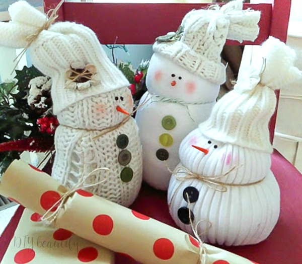 a trio of snowmen crafted from sweaters