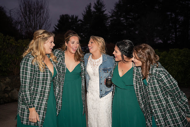 Bride with Bridesmaids in flannel laughing at night Magnolia Farm Asheville Wedding Photography captured by Houghton Photography
