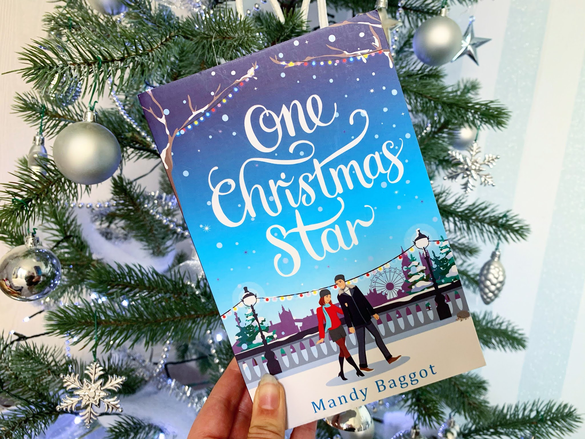 One Christmas Star by Mandy Baggot book under the Christmas tree