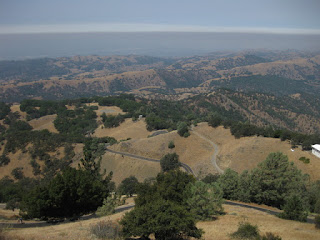 Layer of gray smoke hangs over the valley, view from summit of Mt. Hamilton, San Jose, California
