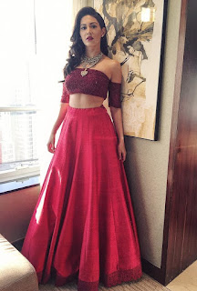 Amyra Dastur in red lehenga by JADE at press conference of her movie Kung Fu Yoga