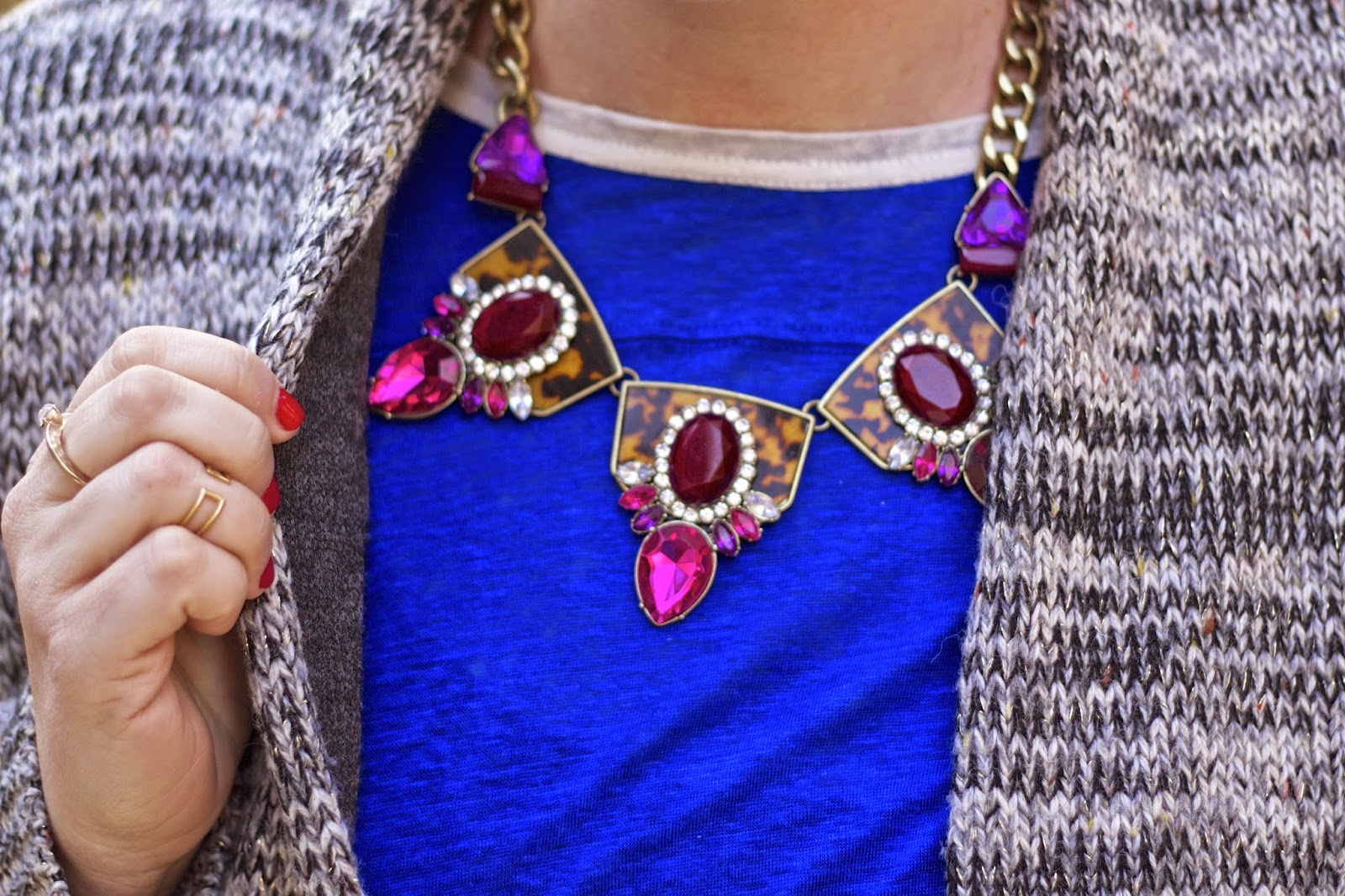 wearing a statement necklace with winter sweater