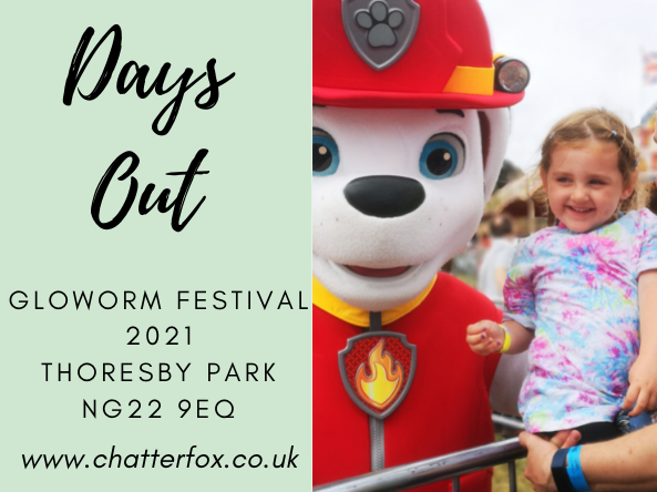 Image of a young girl smiling whilst having her photo taken with Marshall, the dalmation fire fighter from Paw Patrol. Alongside the image is a title that reads 'Days out, Gloworm Children's Festival 2021, Thoresby Park, NG22 9EQ www.chatterfox.co.uk'
