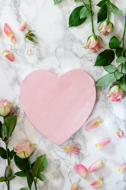Paper Heart and flowers .Photo by Micheile Henderson on Unsplash
