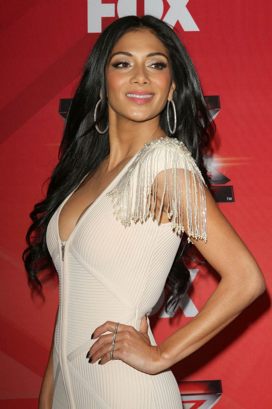 DIRTY MIND'S DELIGHT: Nicole Scherzinger's tightly wrapped boobs.