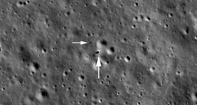 Looking down on the Chang'e 4 landing site; lander is just beyond tip of large arrow, rover at tip of small arrow. Image is 850 meters (2789 feet) across, LROC M1303619844LR. Credits: NASA/GSFC/Arizona State University