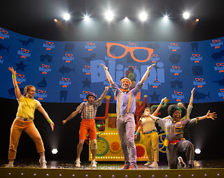 Blippi and his friends dance on stage during Blippi the Musical