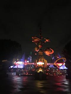 Astro Orbiter Disneyland Wet Ground Reflection Empty
