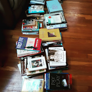 All of my books arranged on the floor