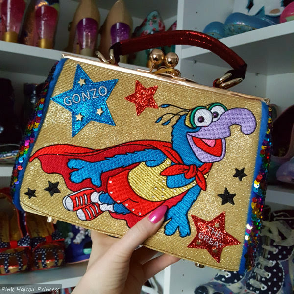 Muppets Gonzo sparkling gold handbag held in hand