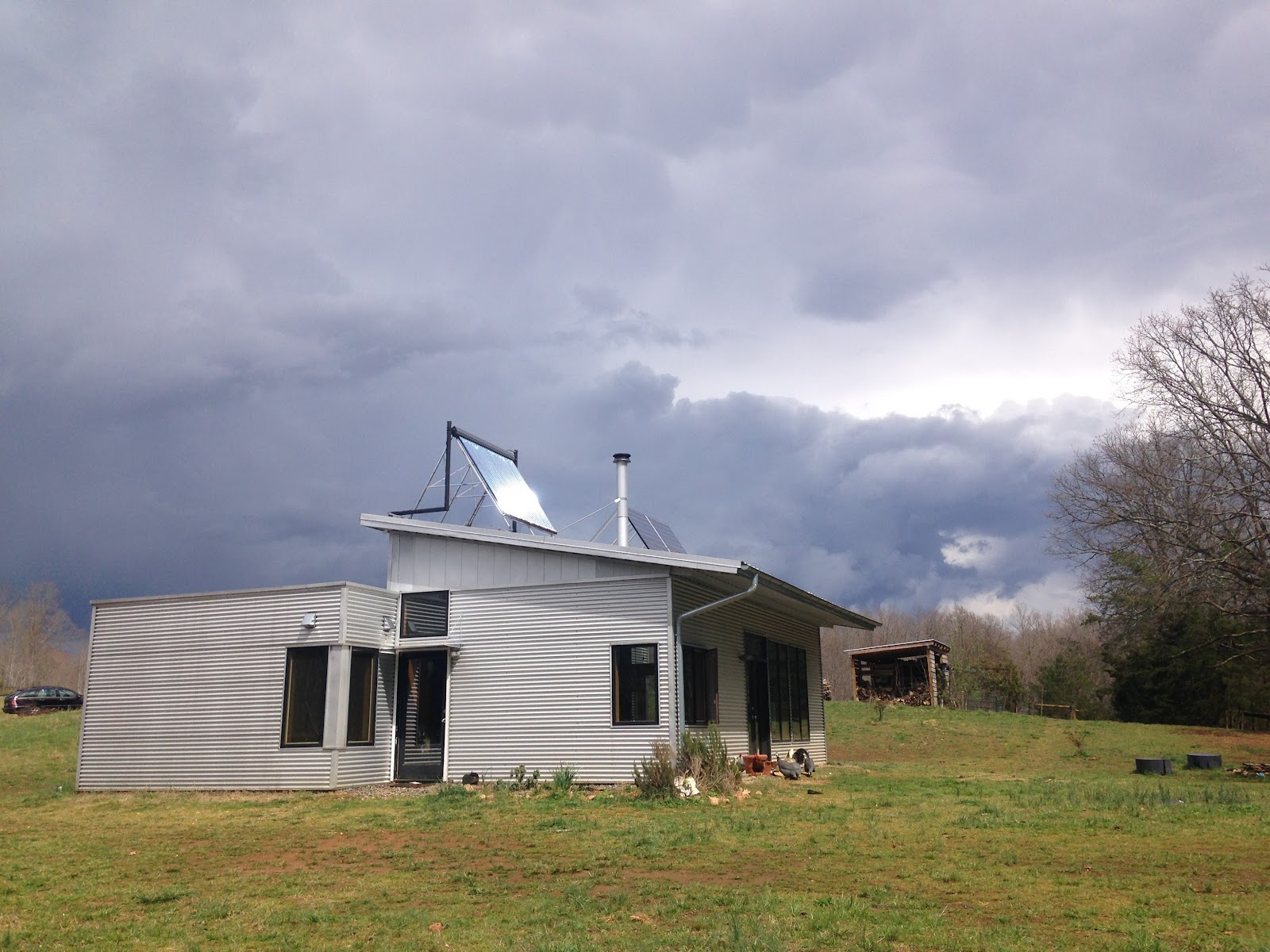 Lotsa rain at the off grid passive solar prefab house and for Passive solar prefab homes