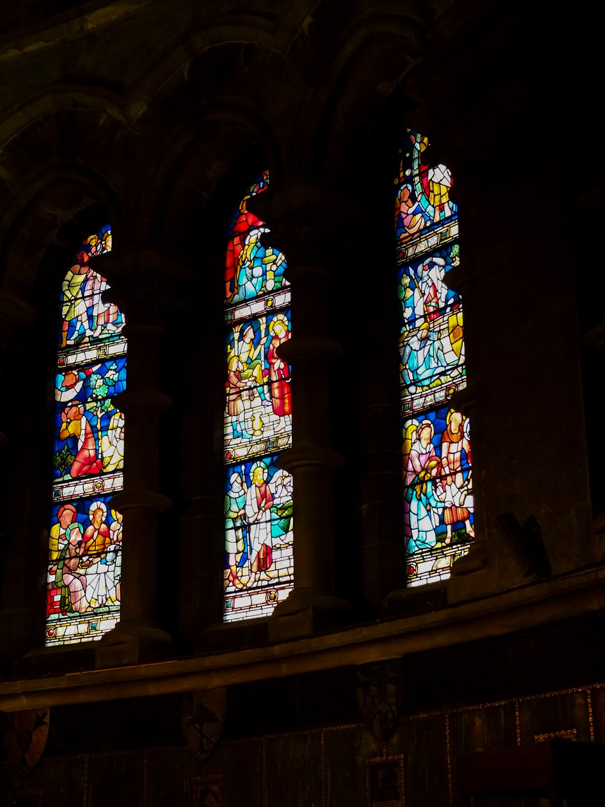 Three stained glass windows inside St. Fin Barre's Cathedral, Cork City.