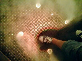 Bristol, at We The Curious Museum, a foot on a metal floor in pretty lights with steam