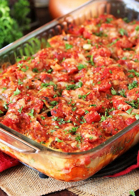 Pan of Ground Beef Stuffed Shells Covered in Sauce Image