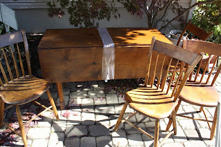 Antique drop leaf table and chairs.