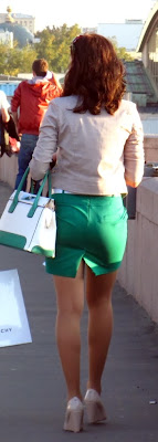 Girl in tight green skirt on the street