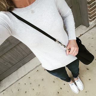 Converse tennis shoes, skinny jeans, gray sweater, kate spade kori handbag
