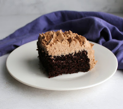 piece of devilishly good chocolate cake with chocolate buttercream