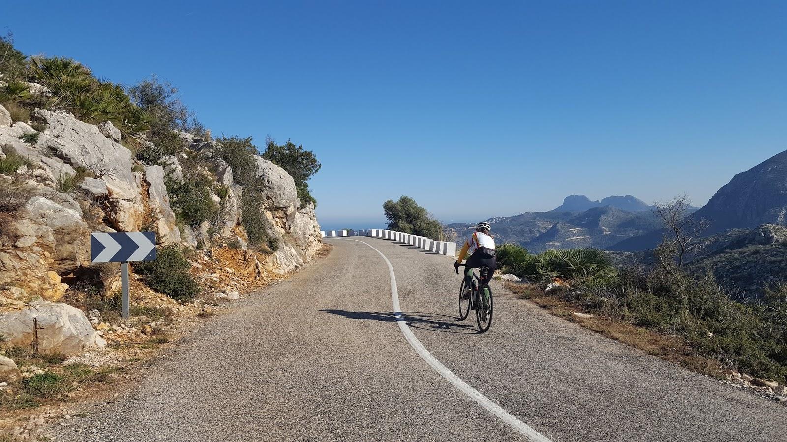 Cyclist descending Vall d'ebo, Alicante, Spain