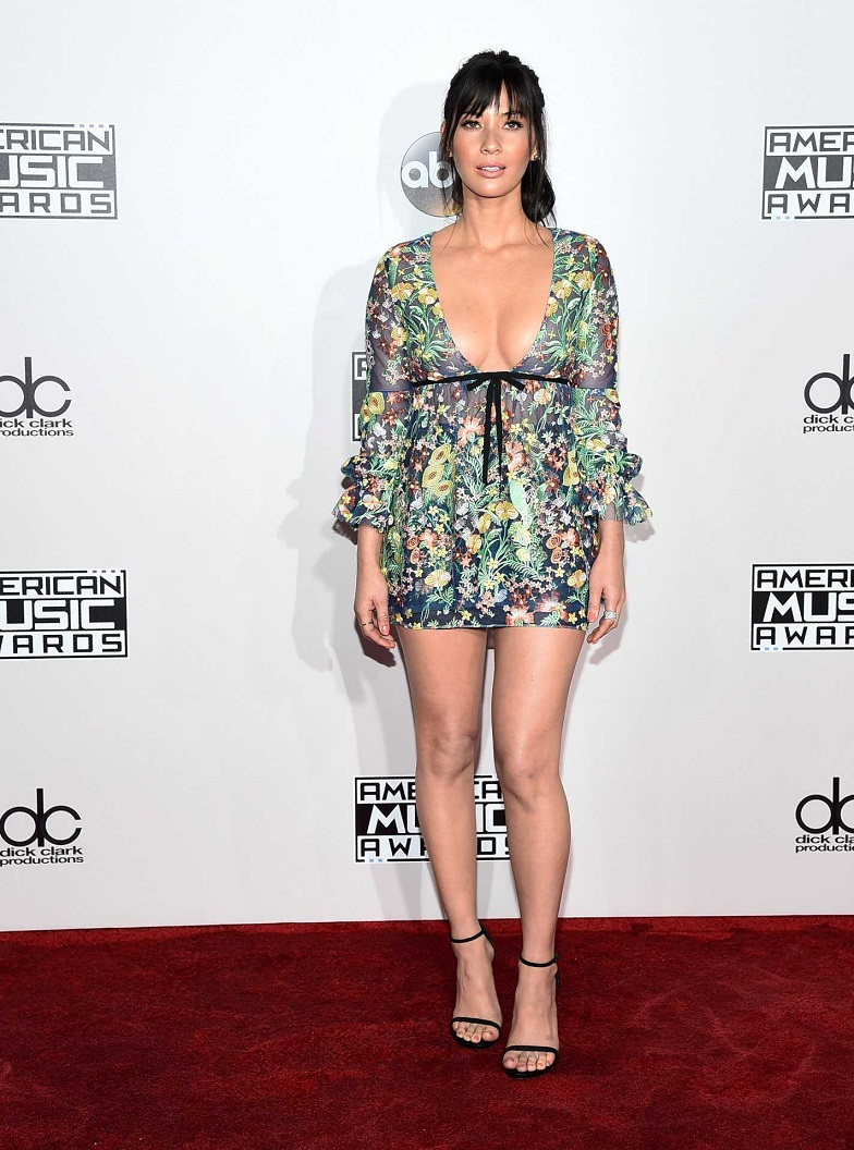 Olivia Munn bares cleavage at the 2016 American Music Awards in LA
