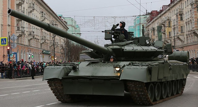 only-in-russia-watch-t-80-tank-pull-bus-out-of-ditch-in-amur-region