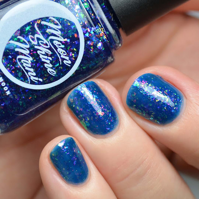 blue jelly nail polish with color shifting flakies swatch