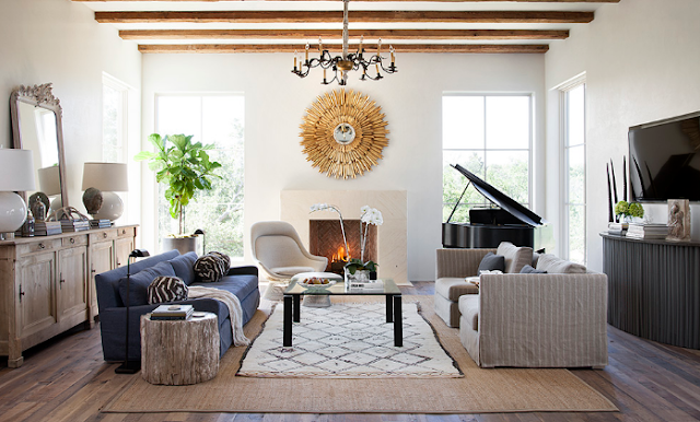 Layer multiple rugs will create warmth in the living room.