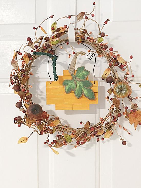 fall wreath with pumpkin