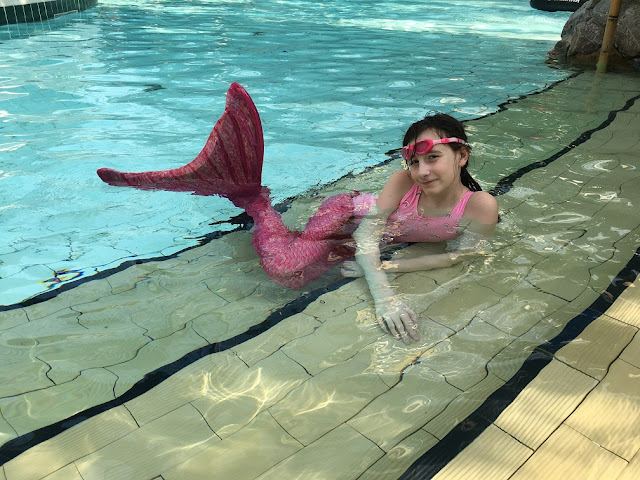 sasha in mermaid tail and fin at center parcs
