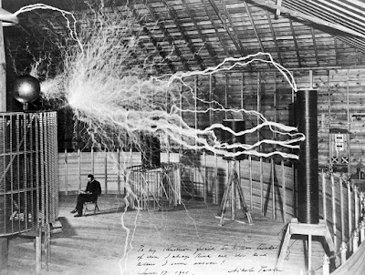 "Tesla with his ""magnifying transmitter"", Colorado Springs, 1899, in photo taken for his 1900 Century Magazine article."