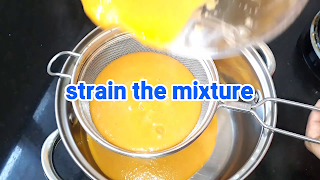image of straining the mixture