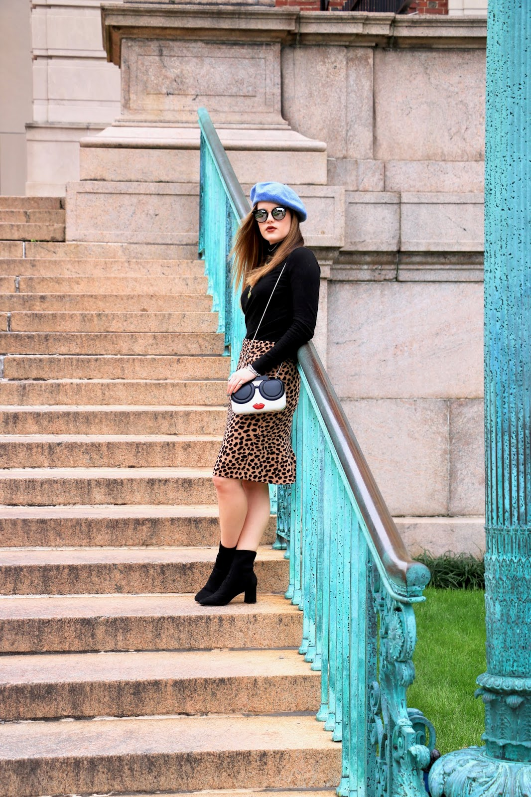 Nyc fashion blogger Kathleen Harper showing how to wear a leopard skirt