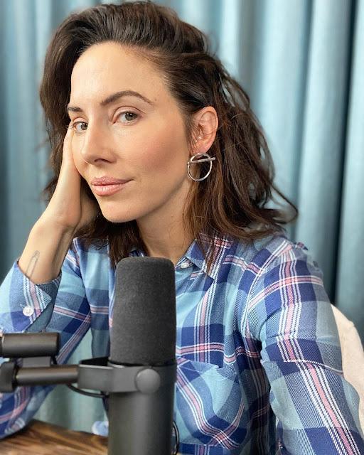 Whitney Cummings wears earrings