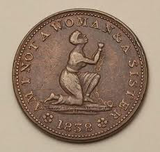 a medal engraved with the slogan of the abolitionist movement