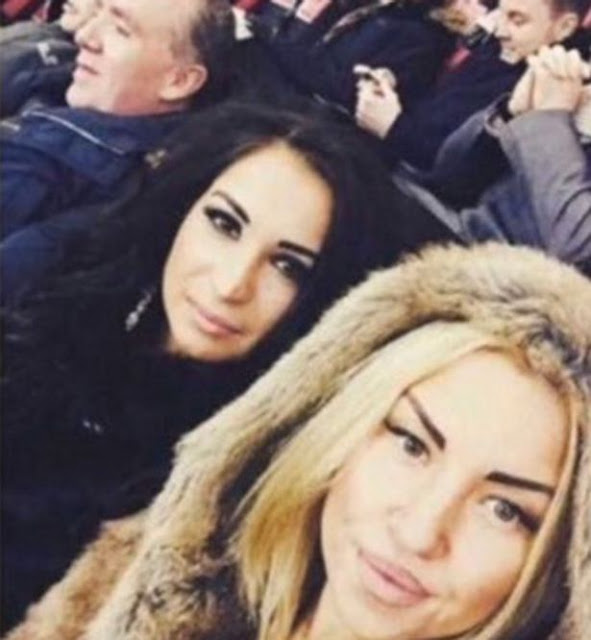 Fans: Liverpool chief executive Ian Ayre spotted alongside two beauties in the stands