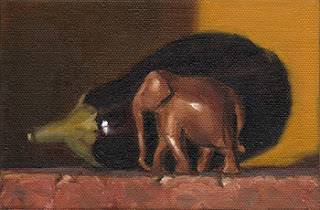 Still life oil painting of a small wooden elephant beside an eggplant.