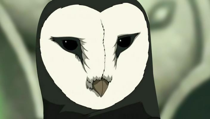 Imagem: o espírito Wan Shi Tong, que toma uma forma de uma enorme coruja de celeiro, com o corpo e a cabeça coberta por penas pretas, o rosto com um círculo branco, olhos pretos e um bico, e no fundo uma construção de pedra enorme.
