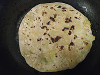 Brown colour marks on aloo paratha cooking on pan