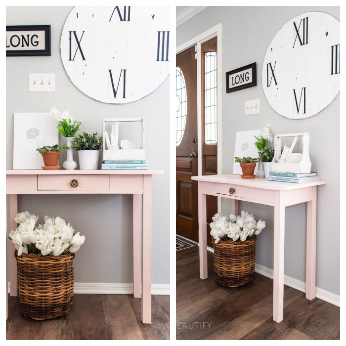 vintage pink entryway table with flowers and books