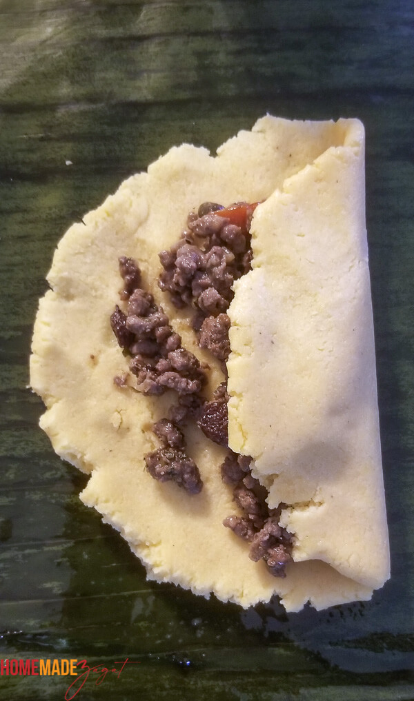 dough with meat filling with one side of dough folded in