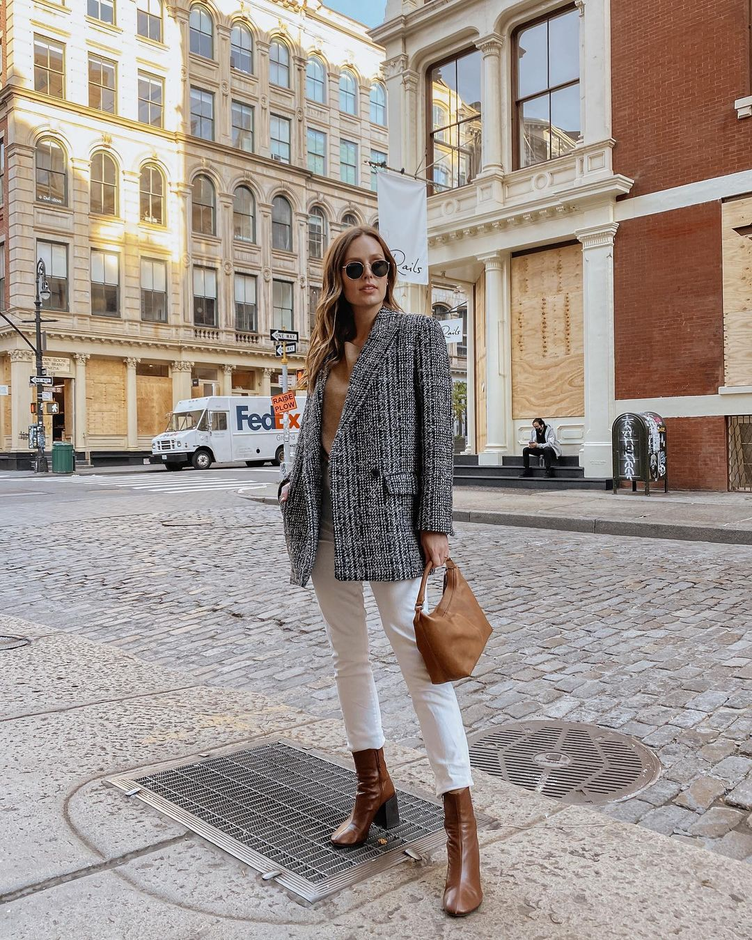 This Outfit is an Easy Business Casual Formula to Copy — @charlottebridgeman instagram outfit idea with a blazer jacket, camel sweater, white jeans, and brown heeled boots