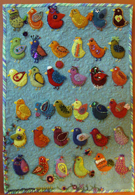 Birds of a Feather Can Dance Together, a wall quilt by Lorraine Jones, embroidery on wool applique